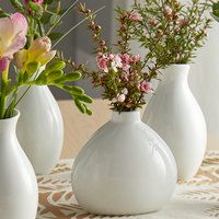 Acopa 3 1/4 inch Bright White Porcelain Bulb Bud Vase - 12/Case