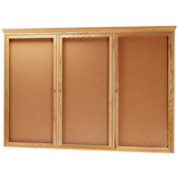 Aarco OBC4872RC 48 inch x 72 inch Enclosed Indoor Hinged Locking 3 Door Bulletin Board with Natural Oak Frame and Crown Molding