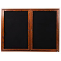 Aarco CDC3648 36 inch x 48 inch Enclosed Indoor Hinged Locking 2 Door Black Felt Message Board with Cherry Frame