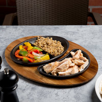 Tablecraft CW301262829 Oval Divided and Crescent Pre-Seasoned Cast Iron Fajita Skillets with Natural Wood-Grain Finish Acacia Wood Underliner