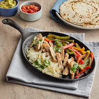 Choice 9 1/4 inch x 7 inch Oval Pre-Seasoned Cast Iron Fajita Skillet with Handle