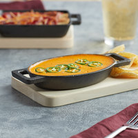 Valor 9 oz. Pre-Seasoned Mini Cast Iron Oval Casserole Dish   - 12/Case