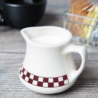 Homer Laughlin 1761791 Maroon Checkers 8.5 oz. Ivory (American White) China Jug Creamer - 24/Case