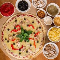 DeIorio's 16 inch Flat Uncooked Pizza Dough - 22/Case