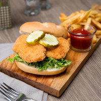 Brakebush Country Style 10 lb. Case 2 oz. Breaded Chicken Breast Sliders