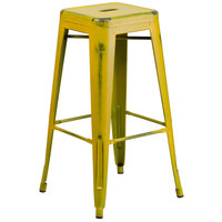 Flash Furniture ET-BT3503-30-YL-GG 30 inch Distressed Yellow Stackable Metal Indoor / Outdoor Backless Bar Height Stool with Square Drain Seat