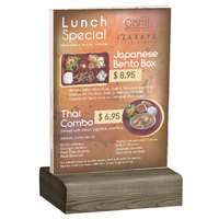 Menu Solutions WBCL-E 5 1/2 inch x 8 1/2 inch Clear Acrylic Table Tent with Solid Weathered Walnut Wood Base