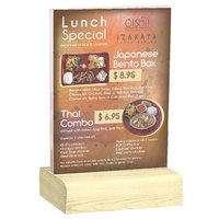 Menu Solutions WBCL-E 5 1/2 inch x 8 1/2 inch Clear Acrylic Table Tent with Solid Natural Wood Base