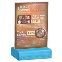 Menu Solutions WBCL-E 5 1/2 inch x 8 1/2 inch Clear Acrylic Table Tent with Solid Sky Blue Wood Base