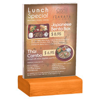 Menu Solutions WBCL-E 5 1/2 inch x 8 1/2 inch Clear Acrylic Table Tent with Solid Mandarin Wood Base