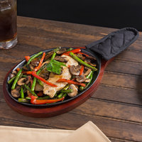 Choice 9 1/4 inch x 7 inch Oval Cast Iron Fajita Pan Set with Mahogany Wood Serving Underliner and Black Cotton Handle Cover