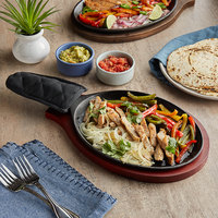 Choice 9 1/4 inch x 7 inch Oval Pre-Seasoned Cast Iron Fajita Skillet with Mahogany Finish Wood Underliner and Black Cotton Handle Cover