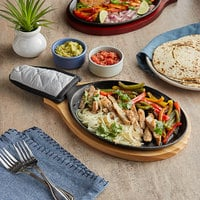 Choice 9 1/4 inch x 7 inch Oval Pre-Seasoned Cast Iron Fajita Skillet with Natural Finish Wood Underliner and Grey Silicone Coated Handle Cover