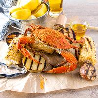 Linton's Seafood 5 1/4 inch Medium Seasoned Steamed Medium Maryland Blue Crabs - 12/Case