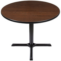 Lancaster Table & Seating Standard Height Table with 36 inch Round Reversible Walnut / Oak Table Top and Cross Base Plate