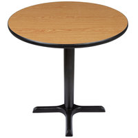 Lancaster Table and Seating Standard Height Table with 30 inch Round Reversible Walnut / Oak Table Top and Cross Base Plate