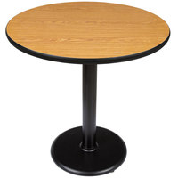 Lancaster Table and Seating Standard Height Table with 30 inch Round Reversible Walnut / Oak Table Top and Round Base Plate