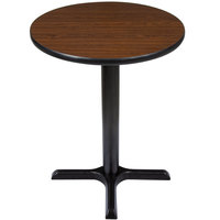 Lancaster Table & Seating Standard Height Table with 24 inch Round Reversible Walnut / Oak Table Top and Cross Base Plate