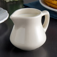 Tuxton BER-055 DuraTux 5.5 oz. Eggshell China Creamer with Handle - 12/Case