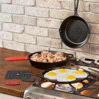 Lodge 7-Piece Essential Pre-Seasoned Cast Iron Skillet Set - Includes 8 inch and 10 1/4 inch Skillets, 10 1/2 inch Griddle, Silicone Handle Holder, Silicone Trivet, and Two Pan Scrapers