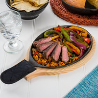 Valor 9 1/4 inch x 7 inch Oval Cast Iron Sizzler Set with Natural Wood Underliner and Black Handle Cover