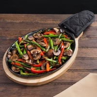 Valor 9 1/4 inch x 7 inch Oval Pre-Seasoned Cast Iron Fajita Skillet with Natural Finish Wood Underliner and Black Cotton Handle Cover