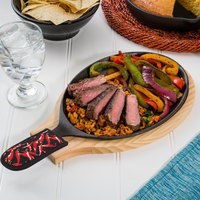 Valor 9 1/4 inch x 7 inch Oval Cast Iron Sizzler Set with Natural Wood Underliner and Chili Pepper Handle Cover