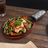 Valor 9 1/4 inch x 7 inch Oval Pre-Seasoned Cast Iron Fajita Skillet with Mahogany Finish Wood Underliner and Grey Silicone Coated Handle Cover