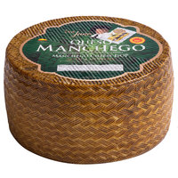 Don Juan 7 lb. 4-Month Aged Queso Manchego DOP Cheese Wheel - 2/Case