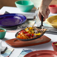 12 5/8 inch x 7 1/8 inch Oval Cast Iron Fajita Skillet with Gripper and Wood Underliner