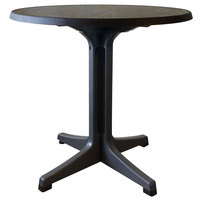 Grosfillex US288744 Omega 34 inch Round Dark Concrete Table with Charcoal Base
