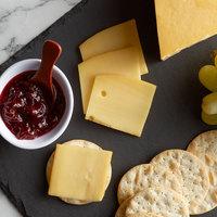 5 lb. Smoked Natural Gouda Cheese Halved - 2/Case