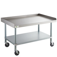 Regency 30 inch x 48 inch 16-Gauge 304 Stainless Steel Equipment Stand with Galvanized Legs, Undershelf, and Casters