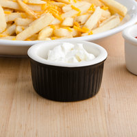 Greenware by Tuxton B4X-0352 3.5 oz. Black / Ivory (American White) Fluted China Ramekin - 48/Case