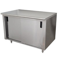 Advance Tabco CB-SS-245M 24 inch x 60 inch 14 Gauge Work Table with Cabinet Base and Mid Shelf