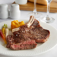 Warrington Farm Meats 14 oz. Frozen Bone-In Ribeye Steak - 12/Case