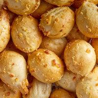 J & J Snack Foods SuperPretzel 0.5 oz. Bite Sized Cheddar Cheese Filled Soft Pretzel Poppers - 240/Case