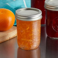 Ball 60000ZFP 8 oz. Half-Pint Regular Mouth Glass Canning Jar with Silver Metal Lid and Band   - 12/Case