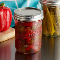 Ball 66000ZFP 16 oz. Pint Wide Mouth Glass Canning Jar with Silver Metal Lid and Band   - 12/Case