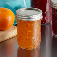 Ball 1440081200 8 oz. Half-Pint Quilted Crystal Regular Mouth Glass Canning Jar with Silver Metal Lid and Band - 12/Case