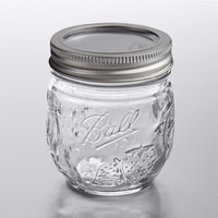 Ball 1440081210 8 oz. Half-Pint Elite Regular Mouth Glass Canning Jar with Silver Metal Lid and Band - 4/Pack