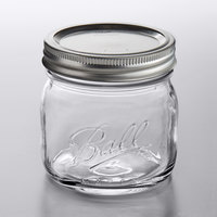 Ball 1440061180 16 oz. Pint Elite Wide Mouth Glass Canning Jar with Silver Metal Lid and Band - 4/Pack