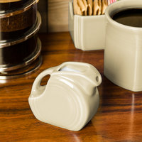Homer Laughlin 475330 Fiesta Ivory 5 oz. Mini Disc Creamer Pitcher - 4/Case
