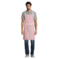 Uncommon Threads 3115 Coral Pink Customizable 100% Cotton Canvas Vibe Bib Apron with Natural Webbing and 3 Pockets - 34 inchL x 36 inchW
