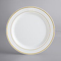 Gold Visions 10 inch Bone / Ivory Plastic Plate with Gold Bands - 12/Pack