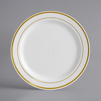 Gold Visions 7 inch White Plastic Plate with Gold Bands - 15/Pack