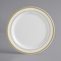 Gold Visions 7 inch Bone / Ivory Plastic Plate with Gold Bands - 15/Pack