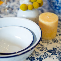 Crow Canyon Home V02BLU Vintage 16 oz. White Round Enamelware Footed Bowl with Blue Rolled Rim