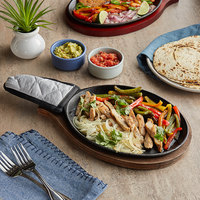 Choice 9 1/4 inch x 7 inch Oval Pre-Seasoned Cast Iron Fajita Skillet with Oak Finish Wood Underliner and Grey Silicone Handle Cover