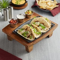 Valor 11 inch x 7 inch Rectangular Pre-Seasoned Cast Iron Fajita Skillet with 14 inch x 10 inch x 4 1/2 inch Rustic Chestnut Finish Display Stand and 1 Dozen Sauce Cups